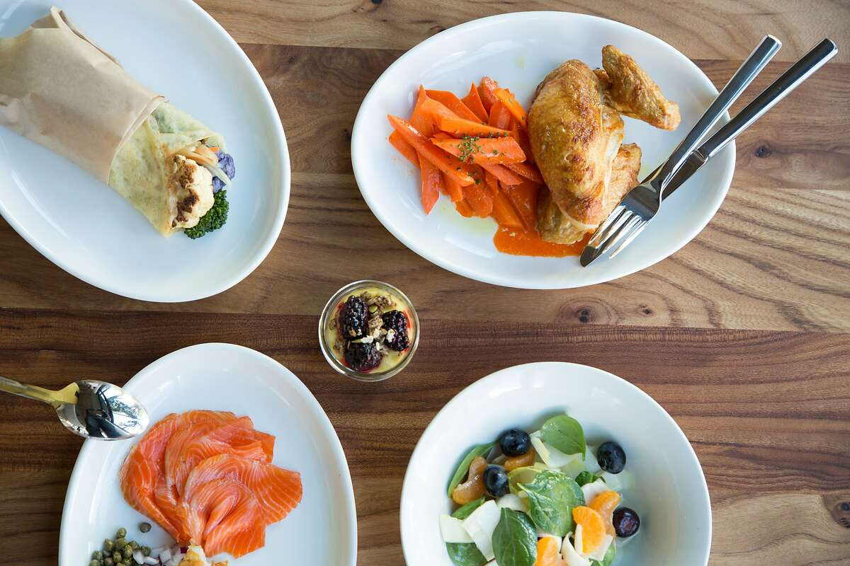 Little Gem, a new restaurant in Hayes Valley, embraces clean eating. Clockwise from top left: Roasted vegetables in a tapioca crepe, roasted chicken with harissa-glazed carrots, spinach and endive salad with blueberries and tangerines, and cured salmon.