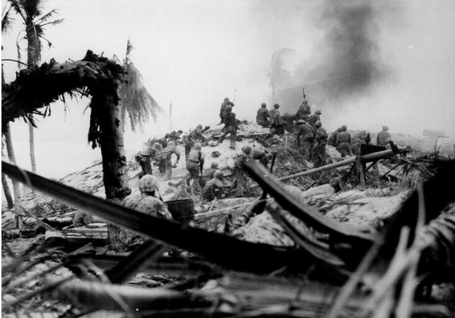 """Marines are shown storming the Pacific Island of Tarawa in November 1943. 1st Lt. Alexander """"Sandy"""" Bonnyman Jr. died in battles there. His skeleton was recently found, seven decades after his family was told he had been buried at sea. Photo: Courtesy Obie Newcomb Jr. / THE WASHINGTON POST"""
