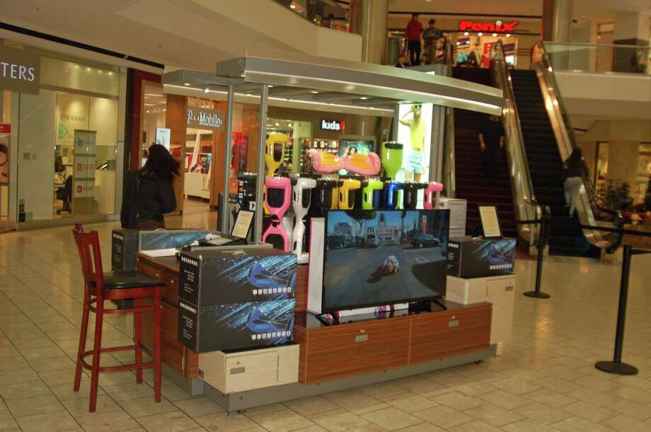 A kiosk at the Stamford Town Center is selling hoverboards, one of the most asked for gifts this holiday season. Photo: Photos By Ken Borsuk / Hearst Connecticut Media / Greenwich Time