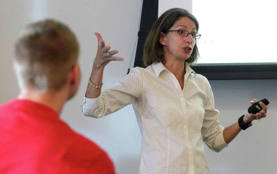 Bioengineer Rebecca Richards-Kortum speaks to her class at Rice University. Photo: J. Patric Schneider, Freelance / © 2015 Houston Chronicle