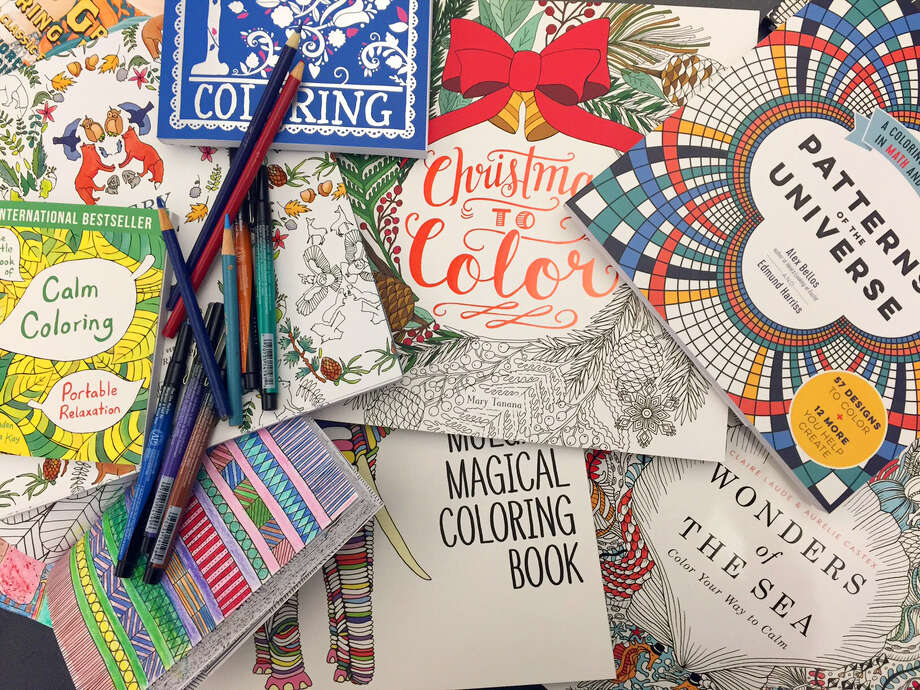 8 2015 Photo Shows A Display Of Adult Coloring Books And Markers