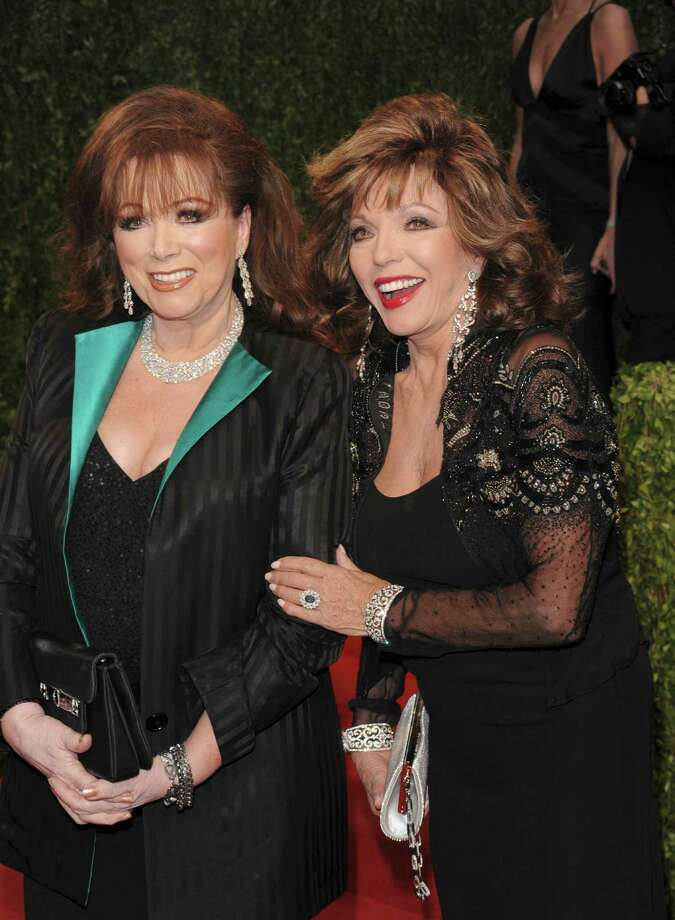 Author Jackie Collins, left, and sister, actress Joan Collins. Photo: Evan Agostini, FRE / AGOEV