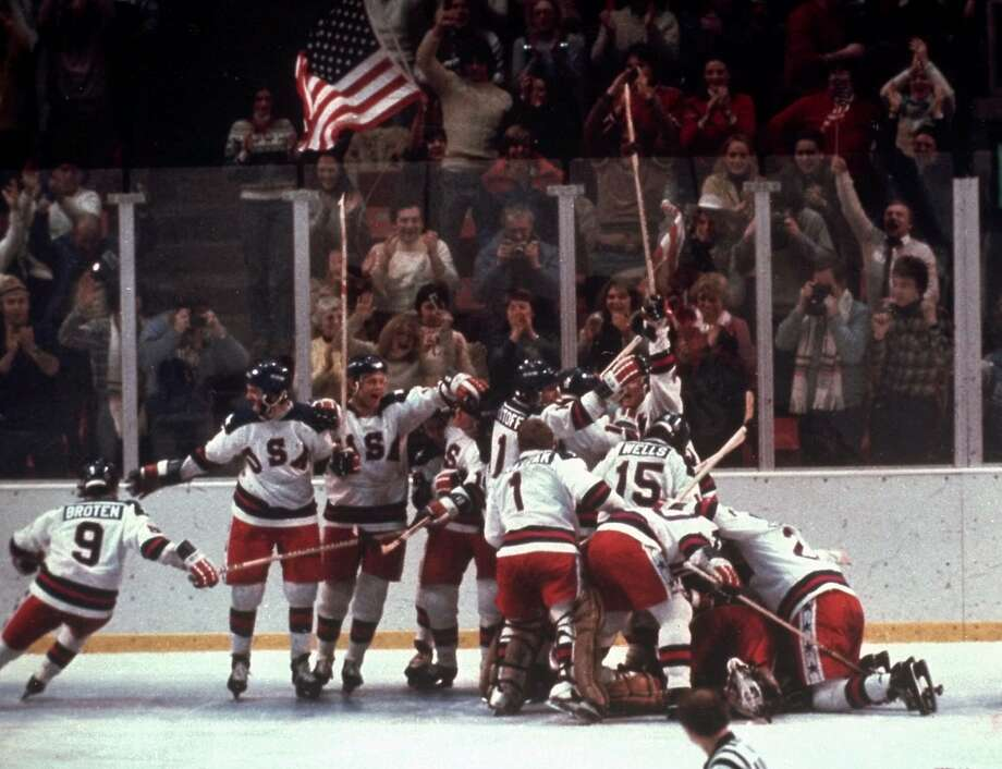 The U.S. hockey team pounces on goalie Jim Craig after a 4-3 victory against the Soviet Union in the 1980 Olympics in Lake Placid, N.Y. Photo: STF / AP