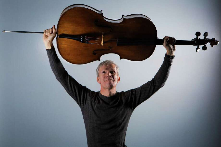 Chris French, an associate principal cellist with the Houston Symphony, is also a personal fitness trainer. He works with clients at Houston Gym. Photo: Marie D. De Jesus, Staff / © 2015 Houston Chronicle
