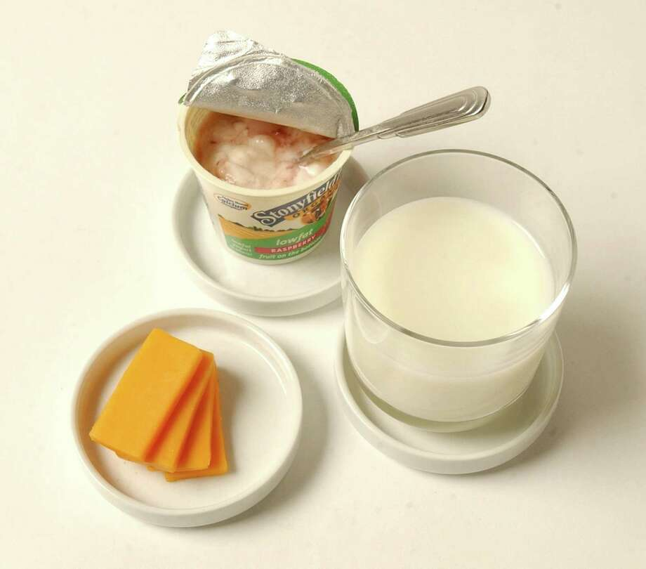 Low-fat yogurt, skim milk and low-fat cheese all provide protein and vitamin D. Photo: Ed Haun, MBR / Detroit Free Press