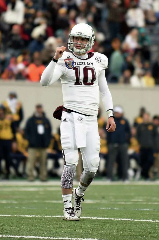 MEMPHIS, TN - DECEMBER 29:  Kyle Allen #10 of the Texas A&M Aggies reacts to a touchdown against the West Virginia Mountaineers during the third quarter of the 56th annual Autozone Liberty Bowl at Liberty Bowl Memorial Stadium on December 29, 2014 in Memphis, Tennessee.  (Photo by Stacy Revere/Getty Images) Photo: Stacy Revere, Stringer / 2014 Getty Images