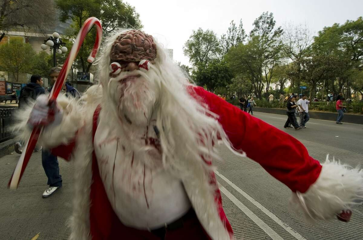 Zombie Santa A man dressed up as a zombie Santa Claus takes part in a