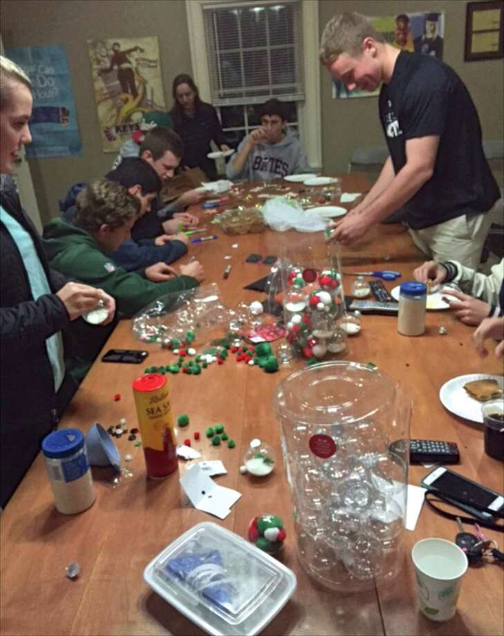 Members of the Boys and Girls Club of Redding keystone club make holiday ornaments for the Tree Musketeer program at the club. Photo: Contributed Photo / The News-Times / The News-Times Contributed