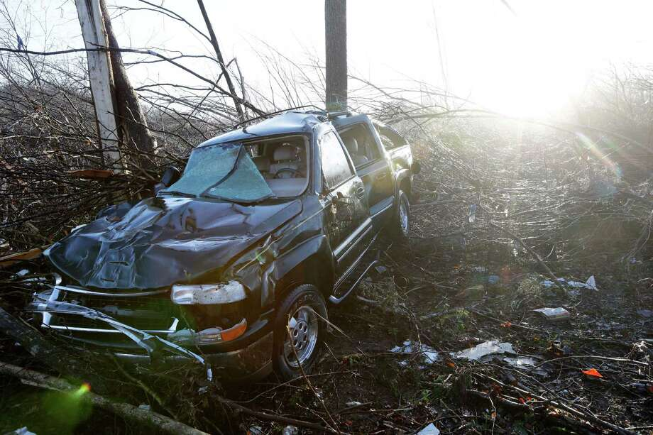 A vehicle sits among debris near the home of Antonio Yzaguirre, 70, and his wife, Ann Yzaguirre, 69, Thursday, Dec. 24, 2015, near Linden, Tenn. The couple was found dead after severe storms went through the area Wednesday night. Several people were killed in Mississippi, Tennessee and Arkansas as spring-like storms mixed with unseasonably warm weather spawned rare Christmastime tornadoes in the South. (AP Photo/Mark Humphrey) Photo: Mark Humphrey, STF / Associated Press / AP