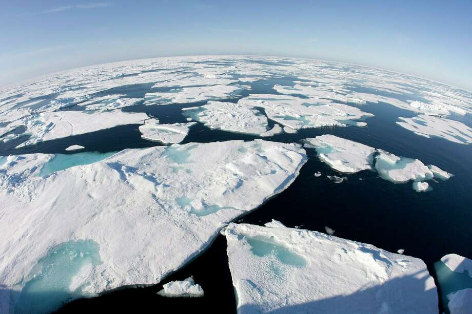 According to the National Oceanic and Atmospheric Administration, 2015 saw a record for sea ice, such as these ice floes at the Arctic Circle's Baffin Bay. Global warming targets adopted in Paris pose difficult choices, scientists say.  Photo: Jonathan Hayward, SUB / The Canadian Press