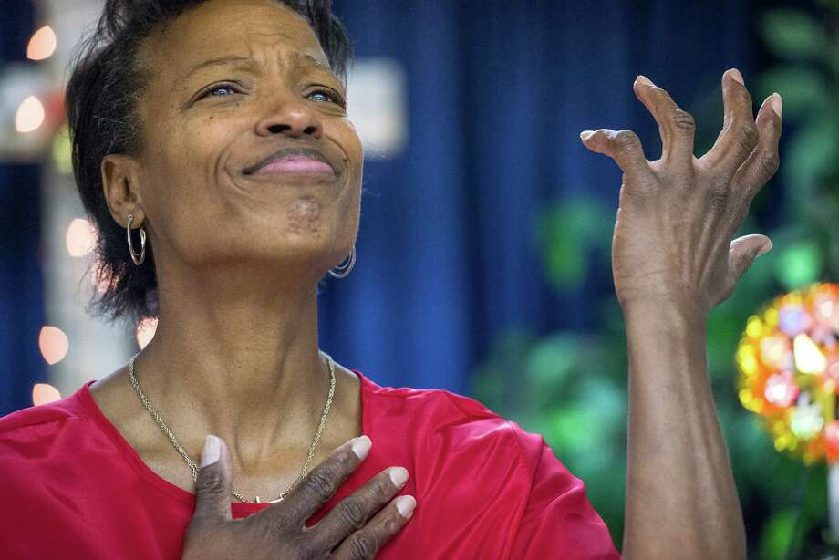 Member of the Hands of Color Choir Ophelia Thomas sings a song in sign language during the Family Deaf Church service at Baptist Temple Church on Sunday, December 20, 2015 in San Antonio. Photo: Matthew Busch, For The San Antonio Express-News / For San Antonio Express-News / © Matthew Busch
