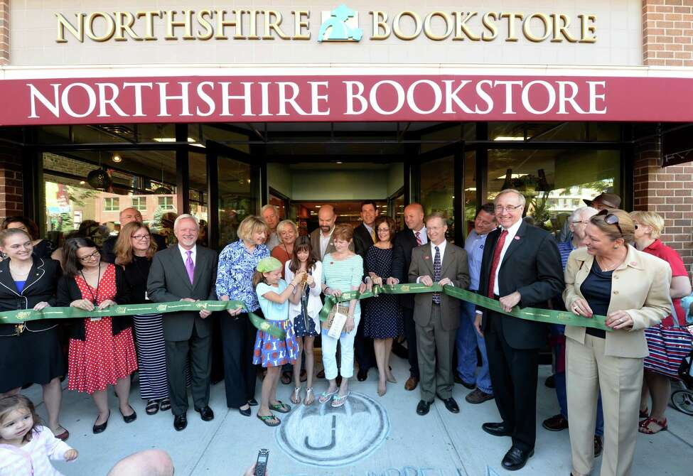 Store owner Chris Morrow is surrounded by well wisher, politicians and patrons at the Northshire Bookstore Aug. 5, 2013 as he opened the store officially in Saratoga Springs, N.Y. (Skip Dickstein/Times Union)