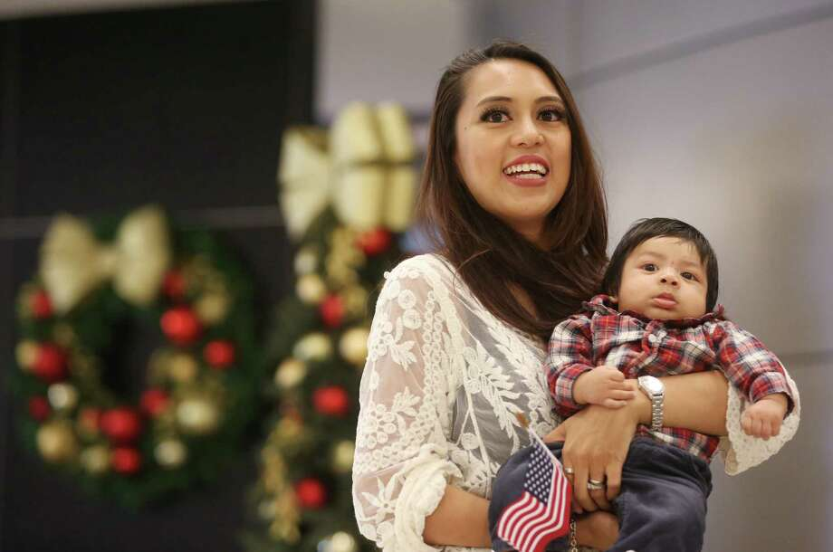 Roxanne Patlan waits with her son Raphael for her husband CJ at Bush IAH Airport Thursday, Dec. 24, 2015, in Houston. Patlan's husband is a Marine stationed in Okinawa, Japan, whose flight home was paid for by a GoFundMe campaign. Photo: Jon Shapley, Houston Chronicle / © 2015  Houston Chronicle