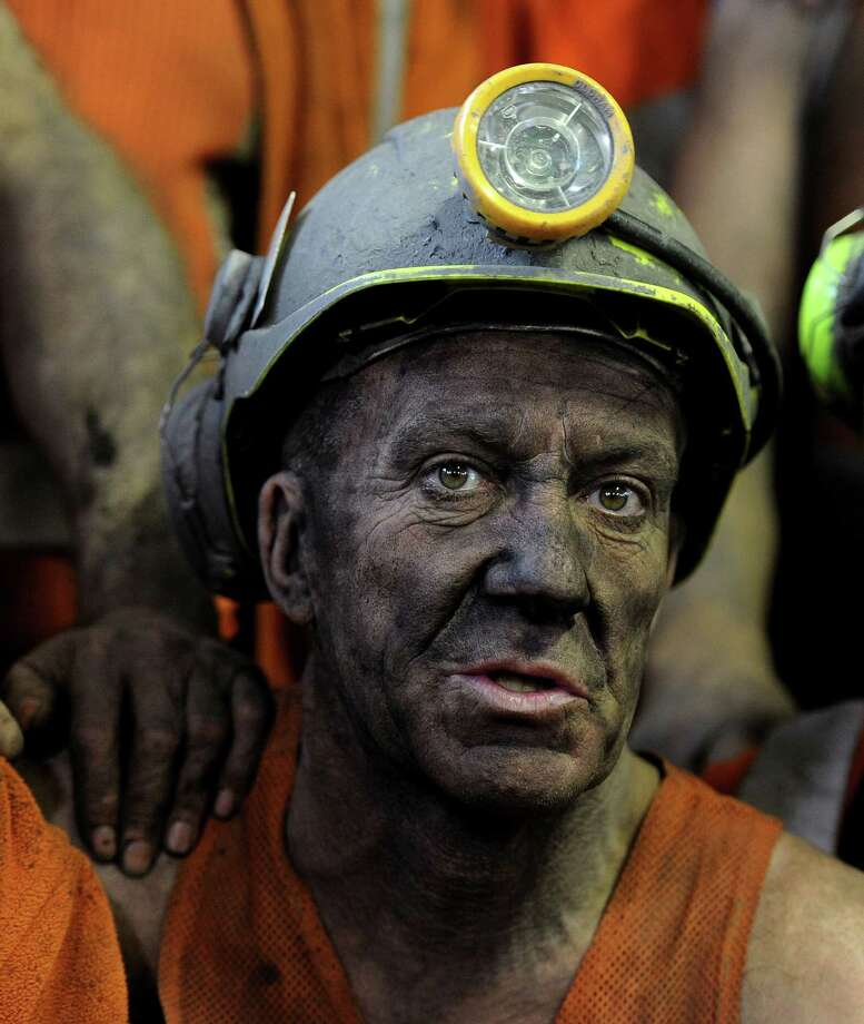 A miner comes off the last shift at Kellingley Colliery in Knottingley, in northern England, on the final day of production. The last haul of coal from the pit will go to a mining museum as a once-mighty industry fades away. Photo: John Giles, SUB / PA