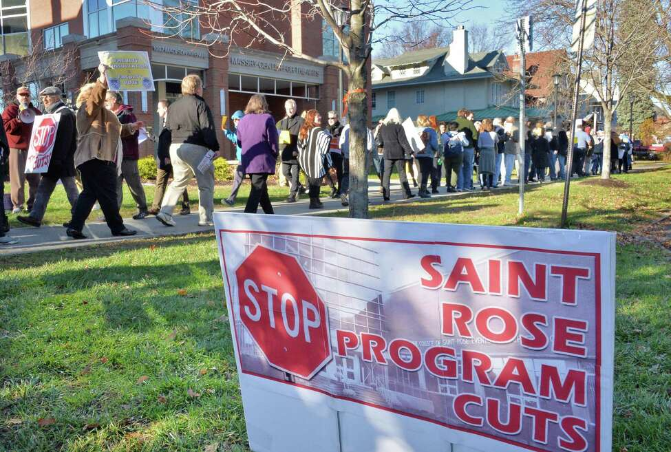 Students, alumni and faculty members rally in response to proposed cuts to academics and faculty layoffs outside the Saint Rose Administration Building on Madison Ave. Friday, Nov. 20, 2015, in Albany, N.Y. (John Carl D'Annibale / Times Union archive)