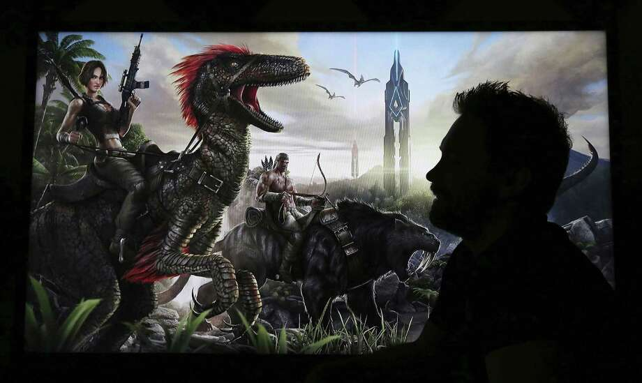 "Jesse Rapczak, right, co-founder of Studio Wildcard, an independent gaming developer, has had success with the game ""Ark: Survival Evolved.""  Photo: Alan Berner, MBR / Seattle Times"