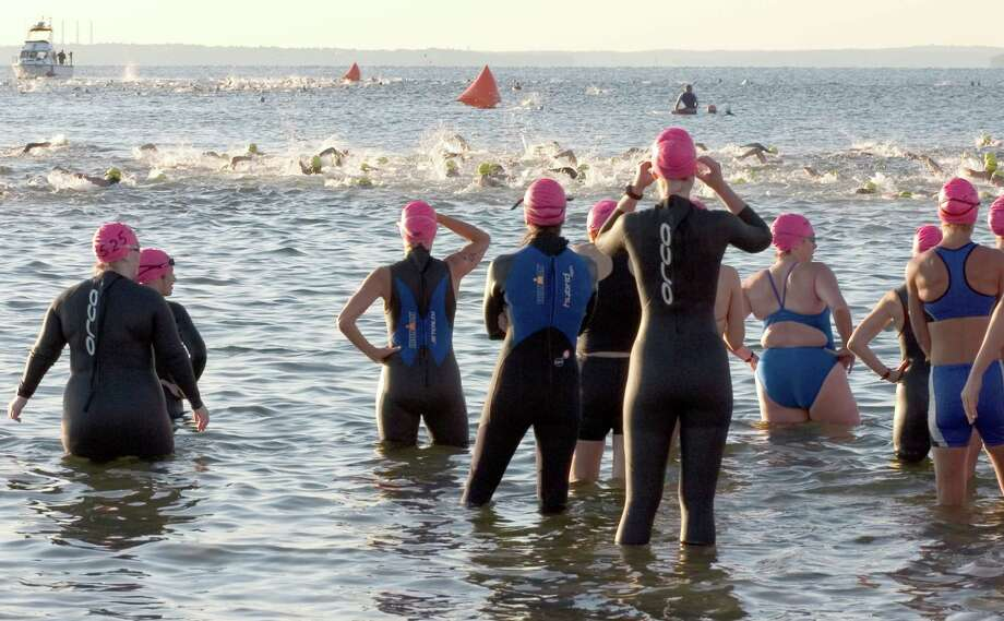 Participants take off on a .5 mile swim in Long Island Sound in the first leg of the 2004 Greenwich Cup Triathalon. Photo: Lindsay France / GT