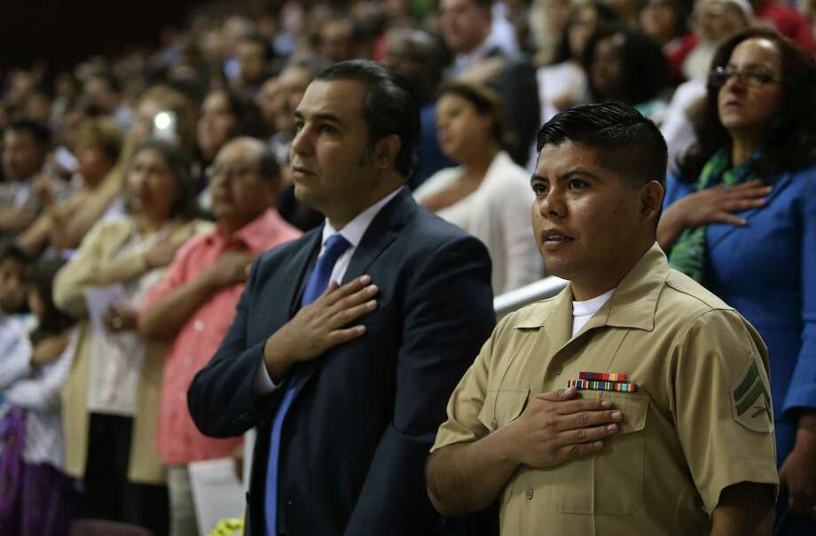 Petitioners take the oath of citizenship at the M.O. Campbell Center in Houston on June 24.  Photo: Mayra Beltran, Staff / © 2015 Houston Chronicle