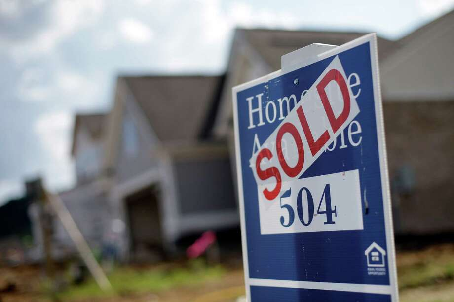 """This home found a buyer in a Nashville subdivision. An economic strategist says mortgage rates in the U.S. """"should not be a major impediment to the housing market"""" even if they do rise a bit in 2016.  Photo: Mark Humphrey, STF / AP"""