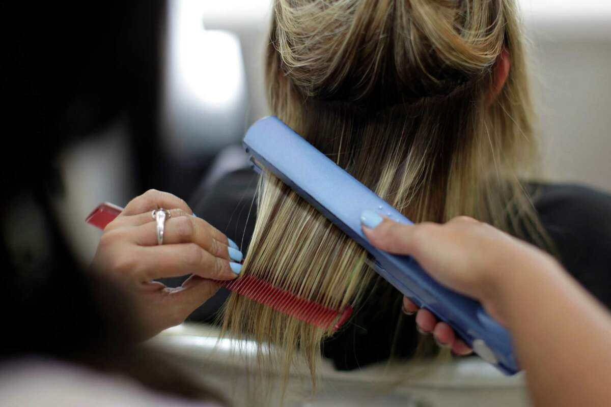 According to the Institute for Justice, no fewer than 34 of the 100-most common low- and moderate-income jobs in Texas require licenses. Barber, Travel Guide. Locksmith. (AP Photo/Felipe Dana, File)