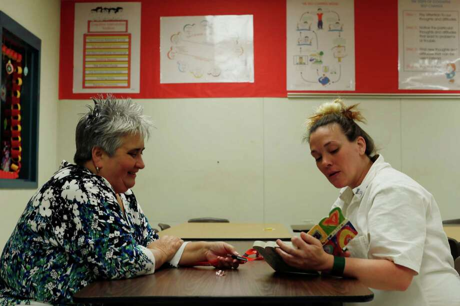 Kristi Dawdy, right, is recorded reading a children's book for her three children as part of the Women's Storybook Project. Photo: Marie D. De Jesus, Staff / © 2015 Houston Chronicle