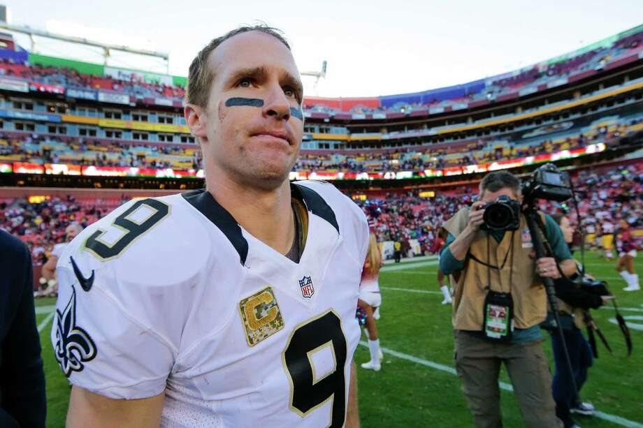 New Orleans Saints quarterback Drew Brees (9) walks off the field after an NFL football game against the Washington Redskins in Landover, Md., Sunday, Nov. 15, 2015. The Redskins defeated the New Orleans Saints 47-14. (AP Photo/Mark Tenally) Photo: Mark Tenally, STF / FR170908 AP