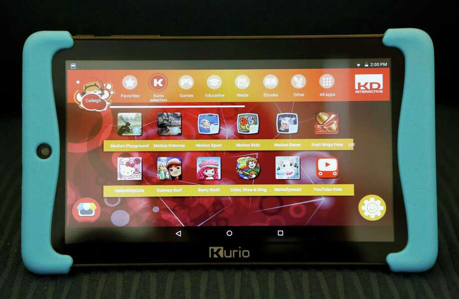 Kurio's latest Android-based Xtreme 2 kids tablet is displayed, Monday, Dec. 21, 2015, in New York. As competition has increased, bad graphics, slow processors, chunky exteriors and child-like operating systems have fallen by the wayside. Today's products feature high-definition screens, speedier operations, fashionably slim bodies and Android-based operating systems, or in one case, Windows 10.  The Xtreme 2 comes with more than 60 preloaded games and apps. (AP Photo/Kathy Willens) Photo: Kathy Willens, STF / Associated Press / AP