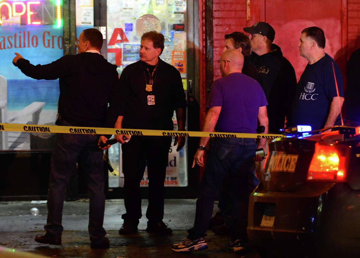Bridgeport police investigate the shooting death of a young man on State Street at Lee Street in Bridgeport, Conn., on Christmas Eve day Thursday Dec. 24, 2015.