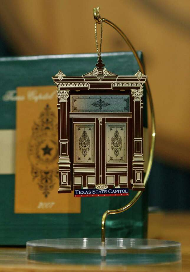 The 2007 Texas Capitol holiday ornament, featuring one of the Capitol's carved wooden doors, is on display at its unveiling. The series has added nearly $8 million to state coffers since it began in 1996, and the ornaments are increasingly sought out by collectors. Photo: Associated Press / AP