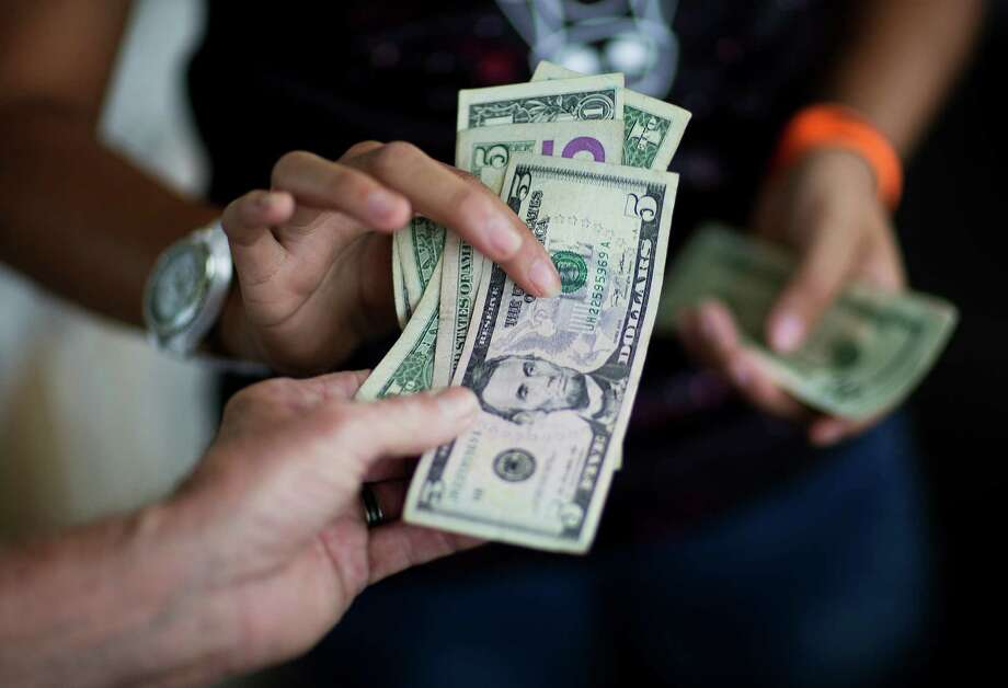 Wage growth has been perhaps the job market's biggest weakness since the recession ended.  Photo: Associated Press File Photo / AP