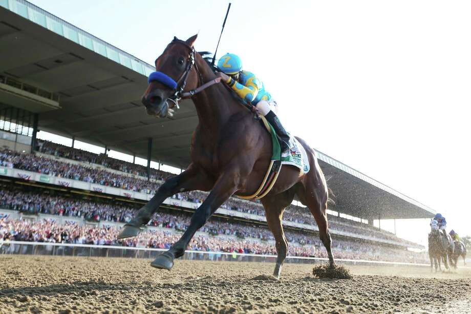 Jockey Victor Espinoza and American Pharoah's sweep of horse racing's Triple Crown was the top sports story of 2015, according to the Associated Press. Photo: Rob Carr, Staff / 2015 Getty Images