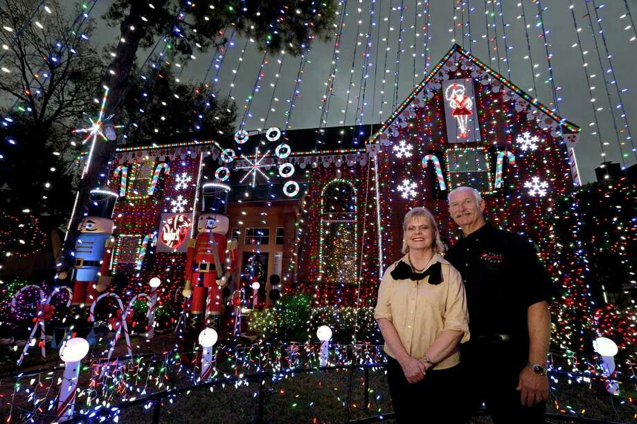 J.D. Schuck and wife D.J. Schuck's Christmas light display has become a Katy tradition and is in its eighth year.  Photo: Gary Coronado, Staff / © 2015 Houston Chronicle
