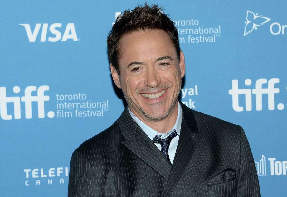 "FILE - In this Sept. 5, 2014 file photo, actor Robert Downey Jr. participates in ""The Judge"" photo call and press conference during the 2014 Toronto International Film Festival, in Toronto. The governor of California pardoned Downey Jr. on Thursday, Dec. 24, 2015, for a nearly 20-year-old felony drug conviction that sent the Oscar-nominated actor to jail for nearly a year. Downey was among 91 people granted pardons for criminal convictions after demonstrating they had rehabilitated themselves and been out of custody for at least 10 years, Gov. Jerry Brown's office announced. (Photo by Evan Agostini/Invision/AP, File) Photo: Evan Agostini, INVL / Invision"