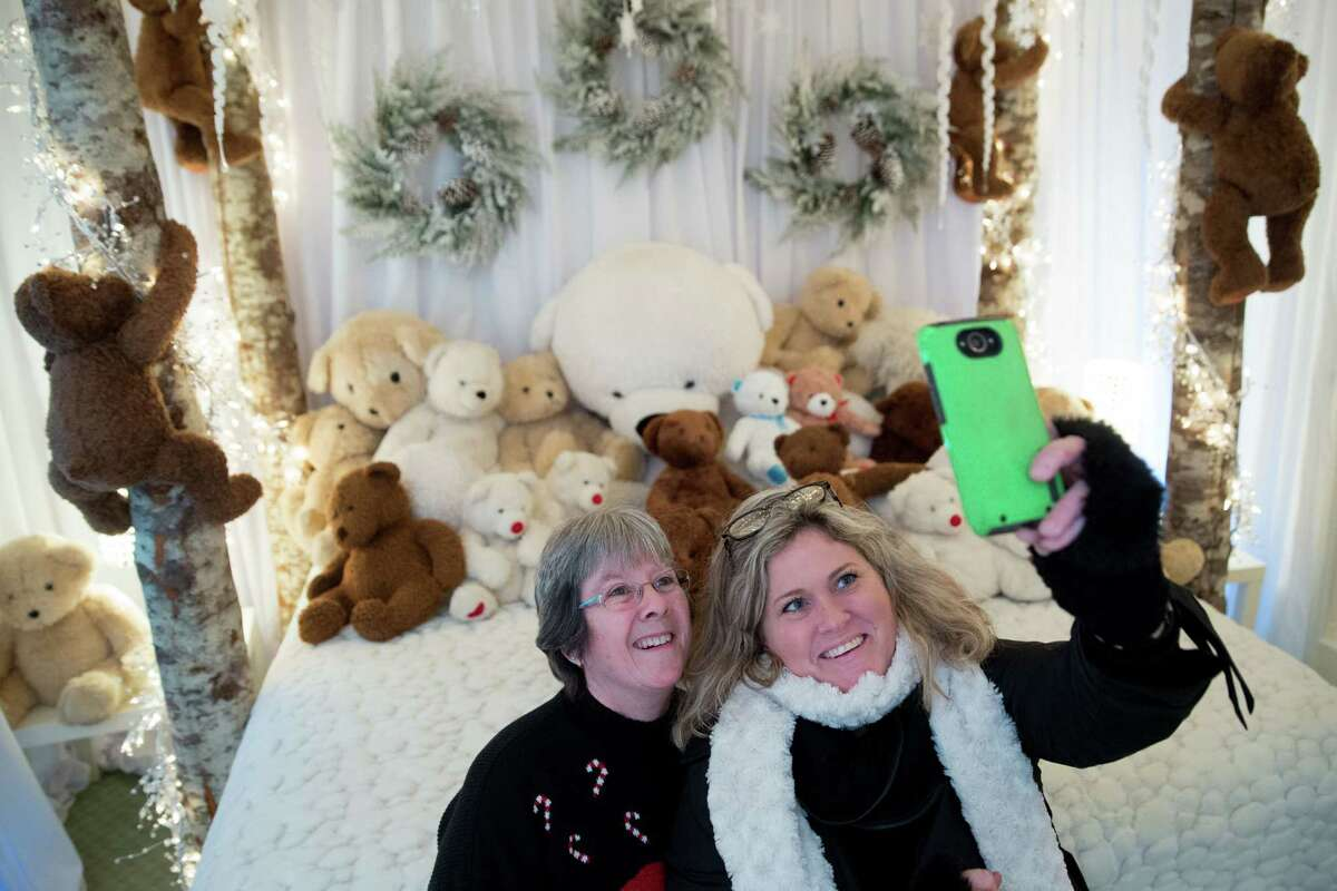 Lindsay Heard and her daughter Stacy Heard take a selfie in the Fairmont Olympic Hotel's annual Teddy Bear Suite, in Seattle on Dec. 24, 2015.