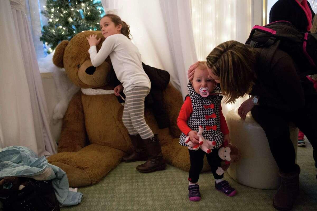 Anya Rivers kisses her daughter Melania.