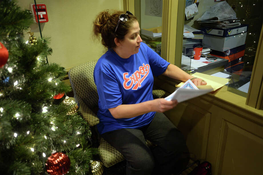 Kristine Smith receives her EJ certificates at the Beaumont Enterprise after donating $1,000 to the Empty Stocking fund on Thursday. Smith was the last to give to the fund in 2015.   Photo taken Thursday, December 24, 2015  Guiseppe Barranco/The Enterprise Photo: Guiseppe Barranco, Photo Editor