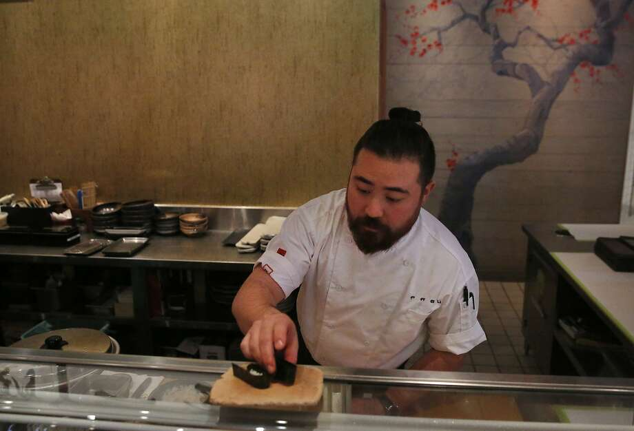 Sous-chef Ben Steigers prepares sushi with uni, or sea urchin, from Japan at Pabu restaurant in San Francisco. Photo: Leah Millis, San Francisco Chronicle