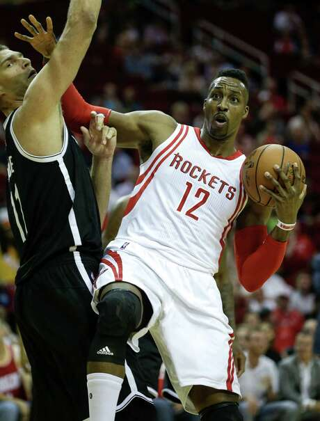 Rockets center Dwight Howard is a favorite target of NBA coaches who foul players intentionally and send them  to the free-throw line, where they are less than stellar. Photo: Brett Coomer, Staff / © 2015 Houston Chronicle