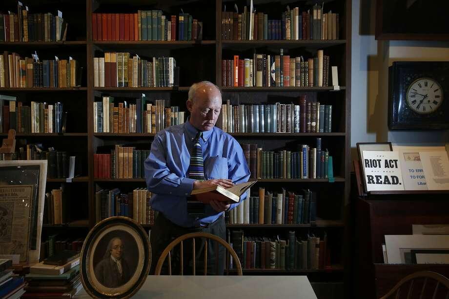 Owner John Crichton poses for a portrait at the Brick Row Book Shop Dec. 24, 2015 in San Francisco, Calif. Photo: Leah Millis, San Francisco Chronicle