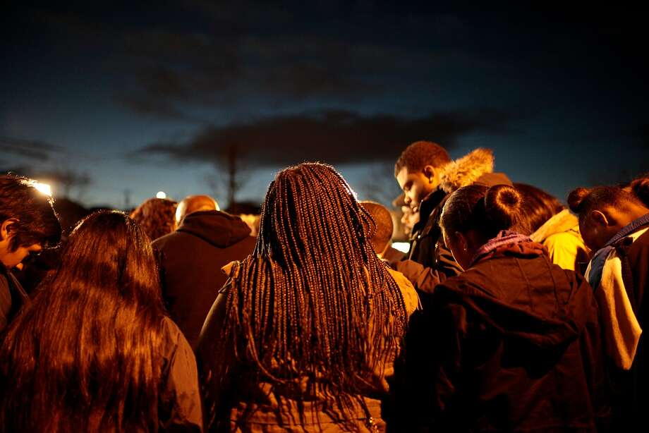 Friends and family gather at a candlelight prayer vigil held for Torian Hughes, the 17-year-old grandson of Oakland City Council President Lynette Gibson McElhaney, at 10th Street & Mandela Parkway on Thursday, Dec. 24, 2015 in Oakland, Calif. Photo: Nathaniel Y. Downes, Special To The Chronicle