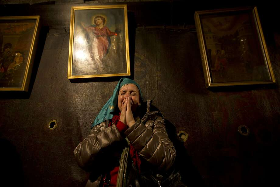 Christian pilgrims pray inside the Grotto of the Church of Nativity, traditionally believed by Christians to be the birthplace of Jesus Christ, in the West Bank town of Bethlehem on Christmas Eve, Thursday, Dec. 24, 2015.  Photo: Majdi Mohammed, Associated Press