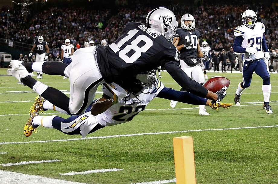 Chargers cornerback Jason Verrett breaks up a pass intended for Raiders wide receiver Andre Holmes (18) on Thursday night. Photo: Tony Avelar, FRE / FR155217 AP
