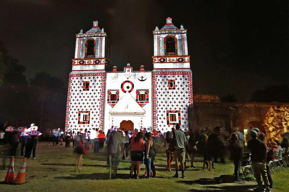 As part of the World Heritage Site Celebrations, The San Antonio Office of Historic Preservation hosts an event at Mission Concepcion on Friday, Oct. 16, 2015. The highlight of the event featured a light projection on the mission of how it originally looked according to officials. Guests were also treated to tours around the mission, music and food. (Kin Man Hui/San Antonio Express-News) Photo: Kin Man Hui, Staff / San Antonio Express-News / ©2015 San Antonio Express-News