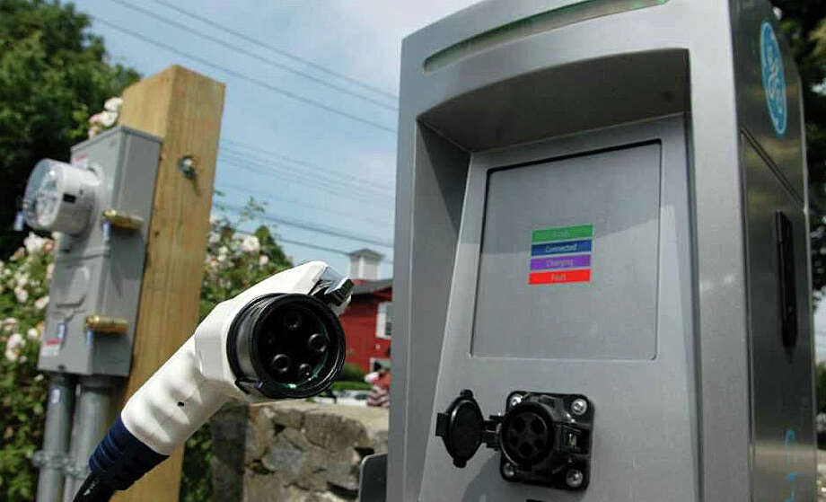 Among the electric vehicle charging stations on municipal property is this one on Sherman Green, and town officials would like to see commercial property owners take advantage of a state program to provide more EV stations on private property in town. Photo: File Photo / File Photo / Fairfield Citizen