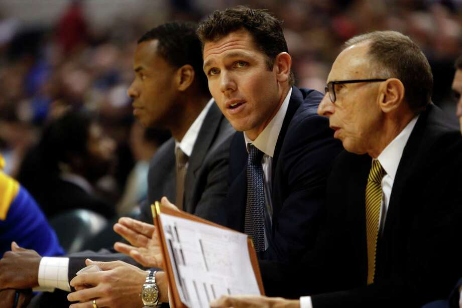 Golden State Warriors' interim head coach Luke Walton with Ron Adams and Jarron Collins against Indiana Pacers during a game at Bankers Life Fieldhouse in Indianapolis on Dec. 8, 2015. Photo: Scott Strazzante /San Francisco Chronicle / ONLINE_YES