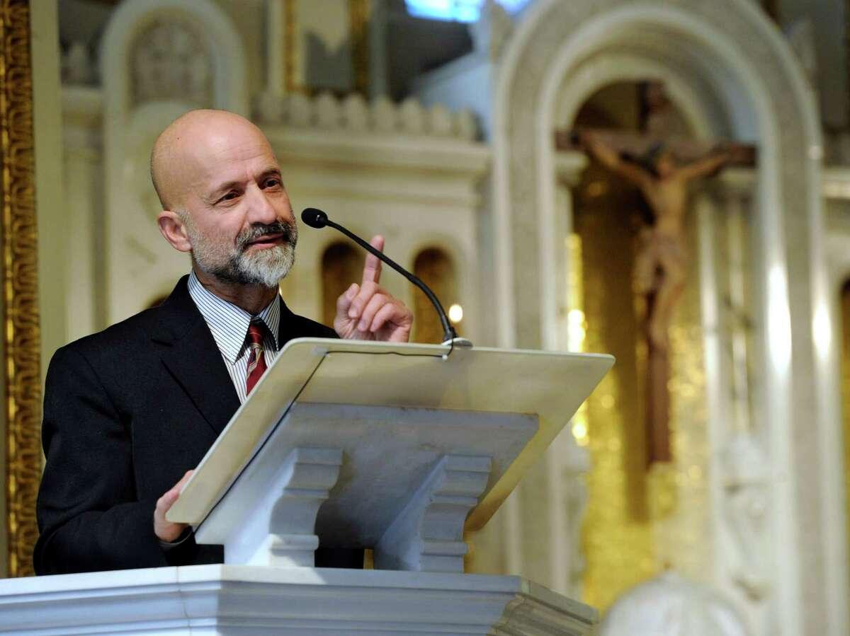 "Michael Seri Jr.speaks at the funeral for his father, Michael ""Tweezer"" Seri Sr., in 2014. ."