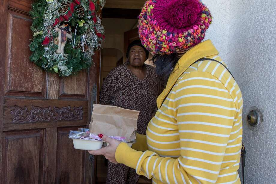 Jenny Tran, greets Helen Lowe, a Meals on Wheels participant, during the Salvation Army's Christmas meal delivery program on Friday, Dec. 25, 2015 in San Francisco, Calif. Photo: Nathaniel Y. Downes, Special To The Chronicle