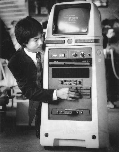 George Sun operates the Hubot robot at a San Francisco Sharper Image store, Sept. 3, 1984. Photo: Gary Fong / The Chronicle / ONLINE_YES