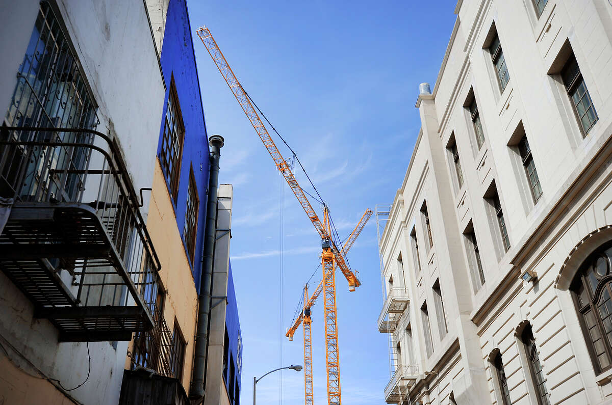 Construction cranes rise above the future California Pacific Medical Center on the site of the old Jack Tar Hotel, Van Ness and Geary, March 30, 2015.