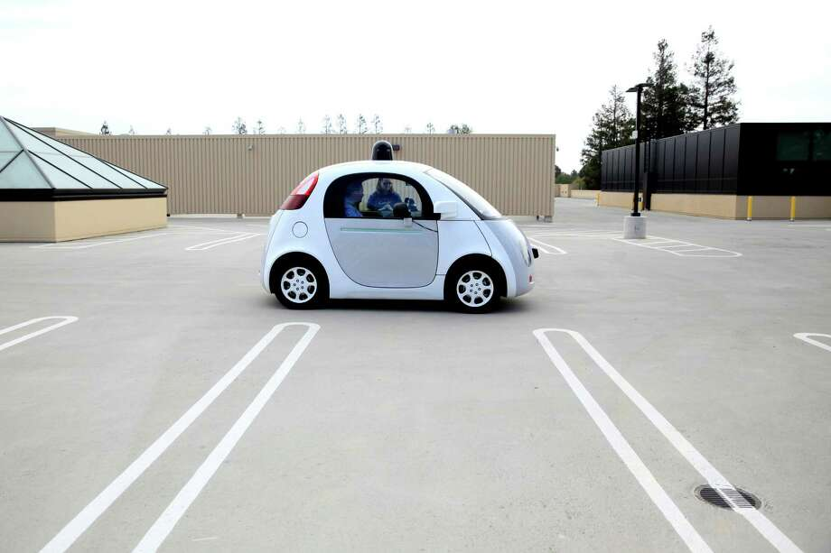A self-driving vehicle sits parked on the roof of a Google building in Mountain View. Photo: Connor Radnovich / The Chronicle / ONLINE_YES